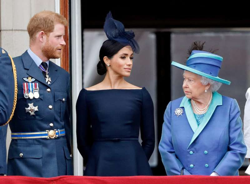 Elizabeth II, Meghan Markle, Prince Harry wearing costumes: Max Mumby/Indigo/Getty Queen Elizabeth, Meghan Markle and Prince Harry