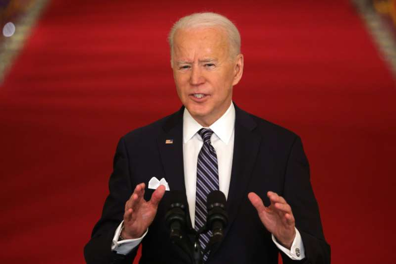 Joe Biden wearing a suit and tie: President Joe Biden speaks during a prime-time televised speech to the nation from the White House in Washington, D.C. on March 11, 2021.