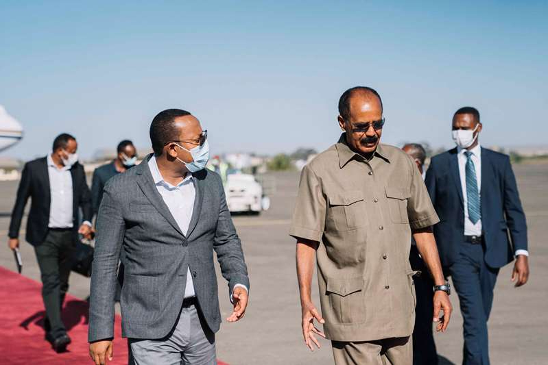 Isaias Afwerki et al. posing for the camera: Ethiopia's Prime Minister Abiy Ahmed travelled to Asmara to meet Eritrea's President Isaias Afwerki on March 25, 2021 [Aron Simeneh/Office of the Prime Minister of Ethiopia via AFP]