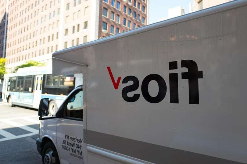 a bus that is parked on the side of a building: Verizon Fios fiber internet service is available in the Northeast, but you'll find other Verizon internet plans, including DSL, LTE and 5G, in other parts of the country, too. Smith Collection/Gado/Getty Images