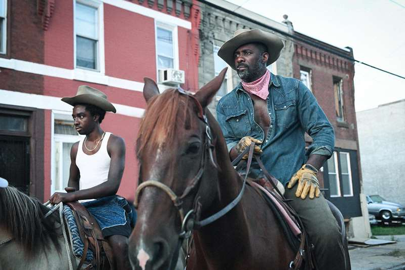 Idris Elba riding a horse: Idris Elba rides hard in coming-of-age Netflix drama 'Concrete Cowboy,' also starring Caleb McLaughlin, Jharrel Jerome, Lorraine Toussaint, Method Man, and more.
