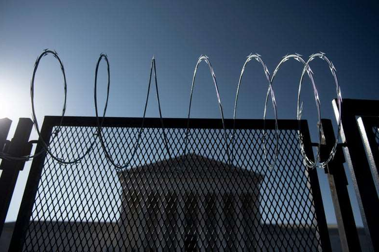 a close up of a fence: Security fencing surrounds the Supreme Court on March 4, 2021, in Washington, D.C. BRENDAN SMIALOWSKI/Getty Images