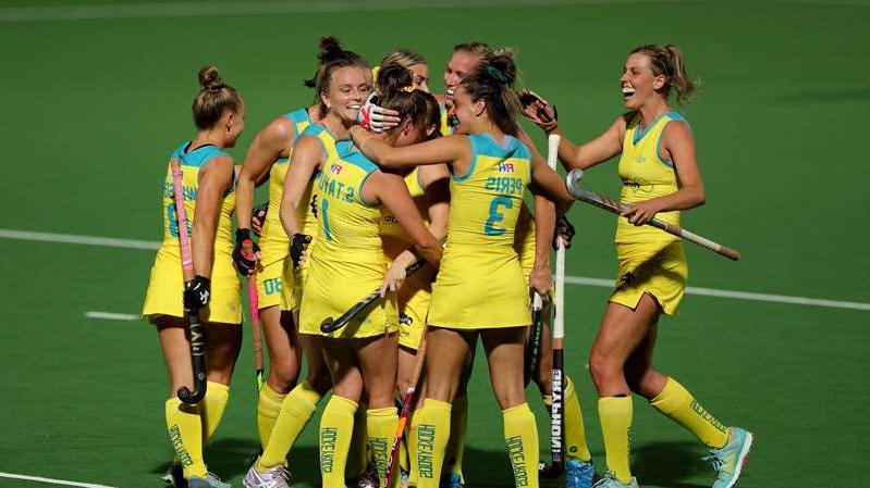 a female football player on a field: The Hockeyroos and Kookaburras haven't played since March 2020.