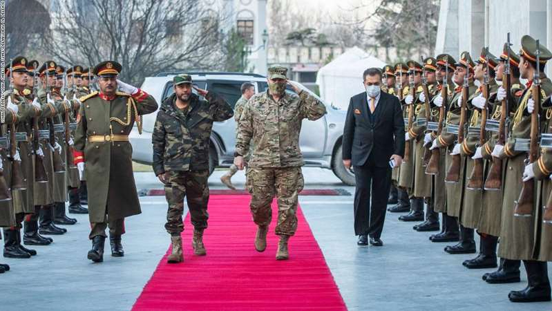 a group of people in uniform: Gen. Mark A. Milley, chairman of the Joint Chiefs of Staff, walks through an honor cordon with Gen. Mohammad Yasin Zia, Chief of General Staff of the Afghan Armed Forces at the presidential palace prior to a meeting with Ashraf Ghani, President of the Islamic Republic of Afghanistan in Kabul, Dec. 17, 2020. The senior leaders discussed the current security environment in Afghanistan.