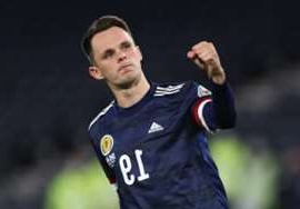 a man holding a ball: Lawrence Shankland