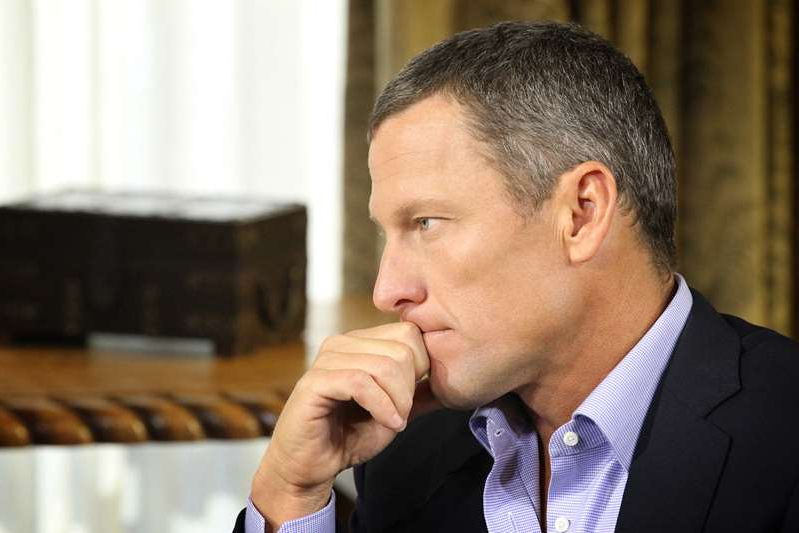 a man wearing a suit and tie: Lance Armstrong during an interview regarding the controversy surrounding his cycling career on January 14, 2013 in Austin, Texas. Armstrong's son Luke Armstrong has been accused of sexually assaulting a 16-year-old girl in 2018.