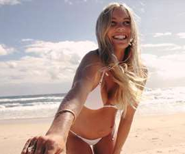 a woman standing on a beach posing for the camera: Byron Baes, Netflix's new Australian reality TV show will follow Byron Bay's Instagram influencer set. But who's in the cast of this upcoming series?