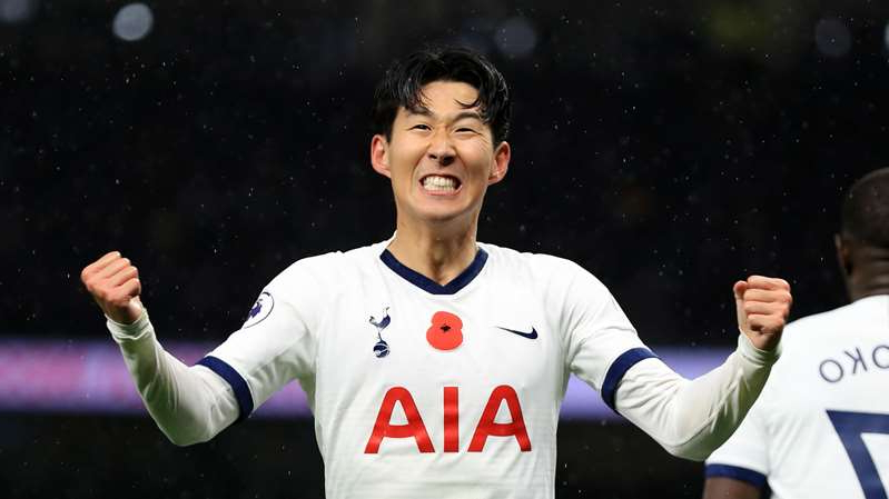 Heung-Min Son holding a football ball: Tottenham forward Son Heung-min