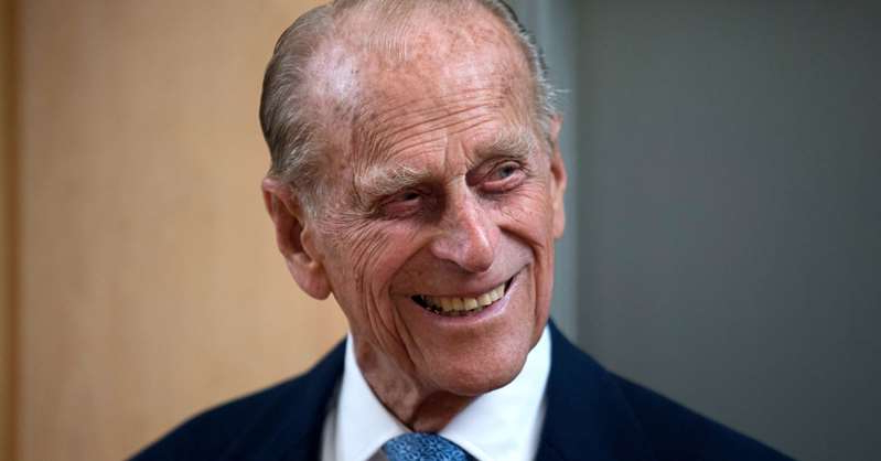 Prince Philip, Duke of Edinburgh wearing a suit and tie smiling and looking at the camera: Prince Philip, Duke of Edinburgh, in 2015.