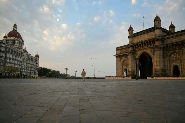 a large stone building: Deserted streets in Mumbai, in India's virus-stricken Maharashtra state