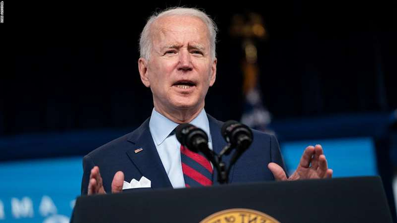 Joe Biden wearing a suit and tie: President Joe Biden speaks during an event on the American Jobs Plan in the South Court Auditorium on the White House campus, Wednesday, April 7, 2021, in Washington. (AP Photo/Evan Vucci)