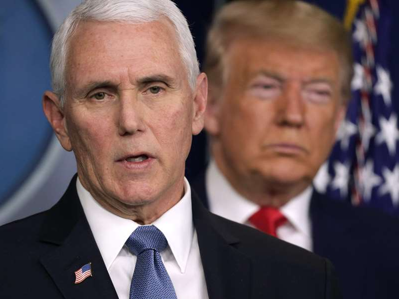 Donald Trump, Mike Pence are posing for a picture: President Donald Trump listens as Vice President Mike Pence speaks at a coronavirus briefing in February 2020. Alex Wong/Getty Images