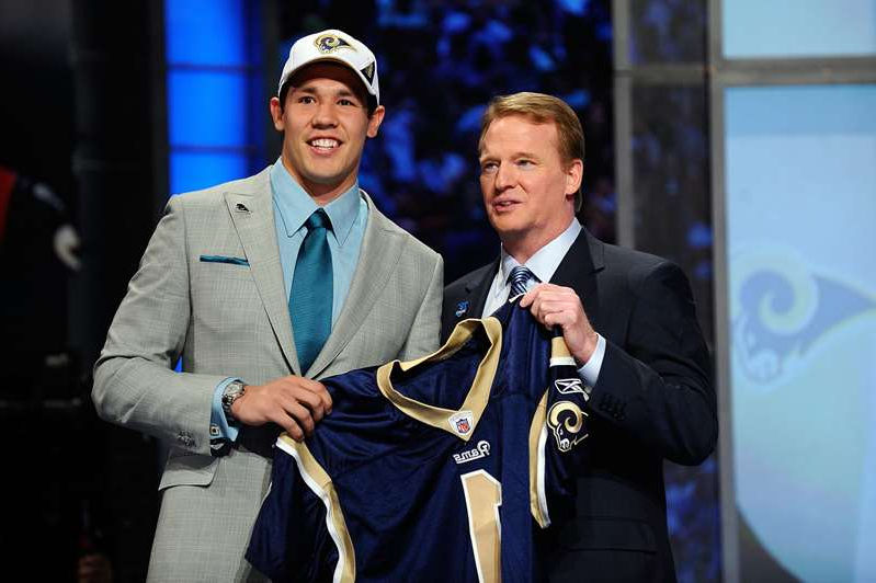 Roger Goodell, Sam Bradford are posing for a picture: Sam Bradford was taken No. 1 overall by the Rams during the 2010 NFL Draft.