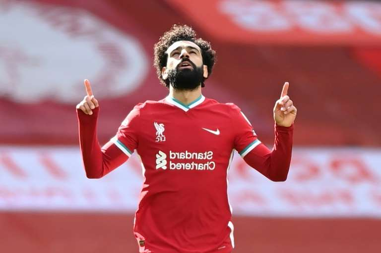 Mohamed Salah celebrates equalising for Liverpool against Aston Villa at Anfield