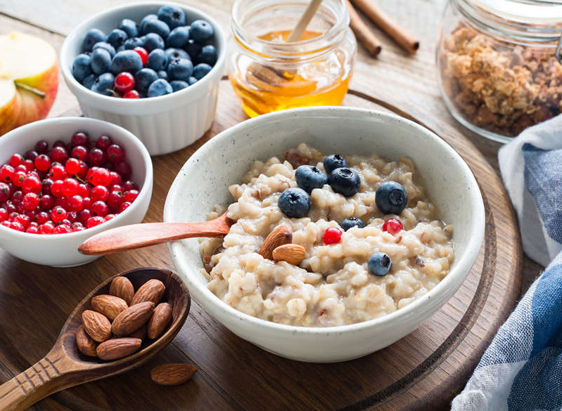 a bowl of food on a table: oatmeal