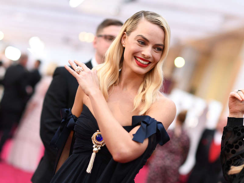 Margot Robbie smiling for the camera: Margot Robbie at the 2020 Golden Globes. Getty/Valerie Macon