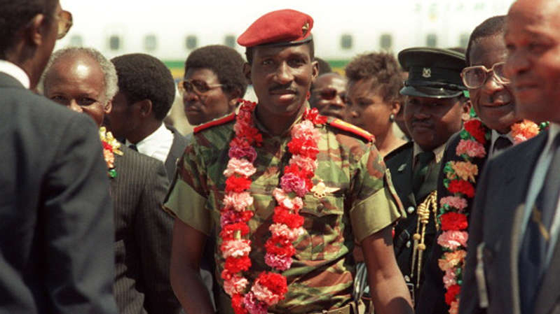 Thomas Sankara et al. standing in front of a crowd: Thomas Sankara led his country from 1983 until his killing in a 1987 coup [File: Getty]