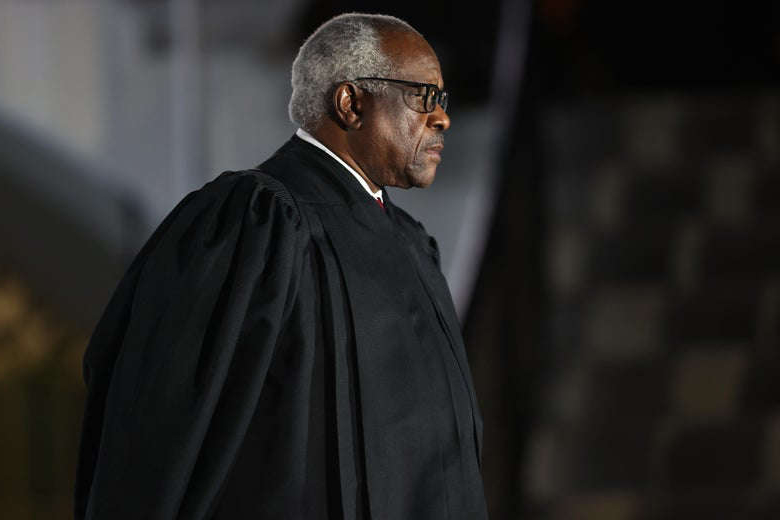 a man looking at the camera: Justice Clarence Thomas attends the ceremonial swearing-in ceremony for Amy Coney Barrett at the White House on October 26, 2020. Tasos Katopodis/Getty Images