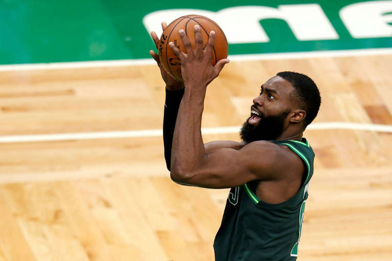 a person holding a basketball: Jaylen Brown scored 40 points to lead the Boston Celtics to a 121-113 win over the Los Angeles Lakers who played in front of a limited number of fans at Staples Center arena for the first time in over a year