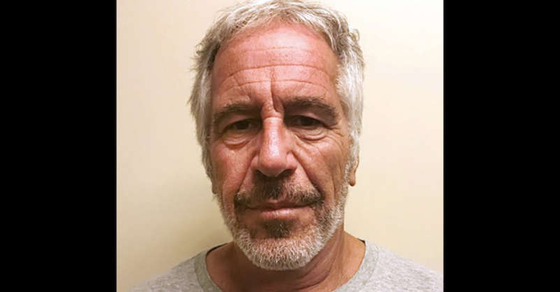 Jeffrey Epstein wearing glasses and smiling at the camera: jeffrey epstein mugshot