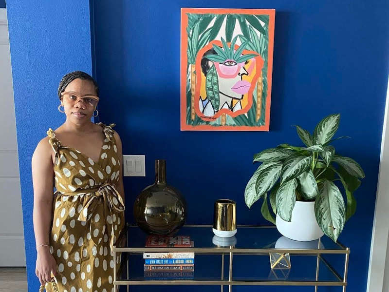 a person standing next to a vase: I work as an interior stylist at my company, DBF Interiors. Photo courtesy of DBF Interiors