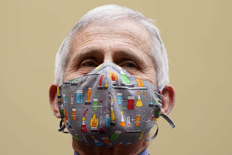 a close up of a giant head: Anthony Fauci, director of the National Institute of Allergy and Infectious Diseases, wears a protective mask during a Select Subcommittee On Coronavirus Crisis hearing in Washington, D.C., U.S., on Thursday, April 15, 2021. Top U.S. health officials, set to testify Thursday at a House hearing, are likely to face questions about the governments decision to pause use of Johnson & Johnsons Covid-19 vaccine after a small number of recipients developed severe blood clots.