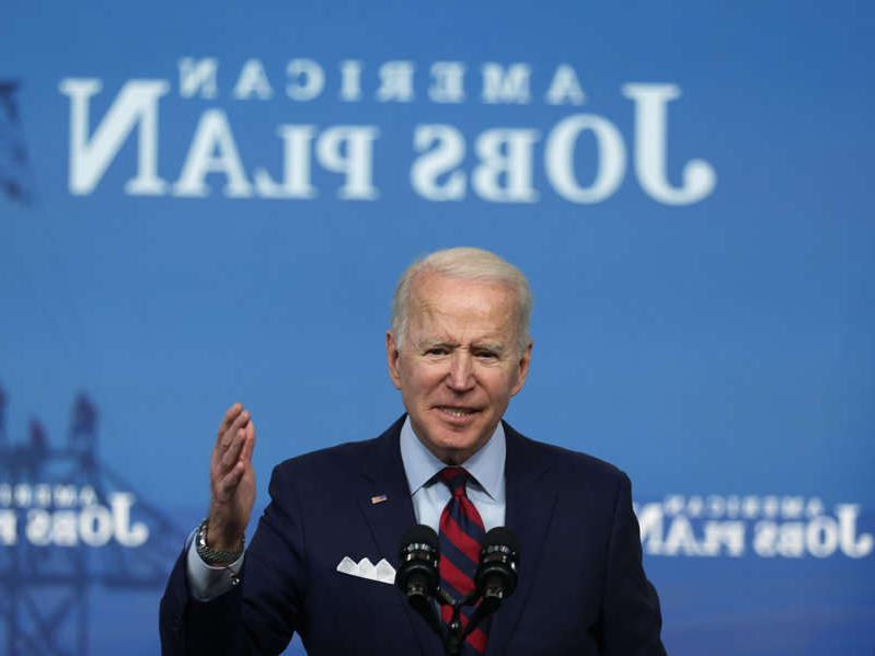 Joe Biden wearing a suit and tie: President Joe Biden has framed his infrastructure plan as a means of strengthening democracy and undermining autocracy. Alex Wong/Getty Images