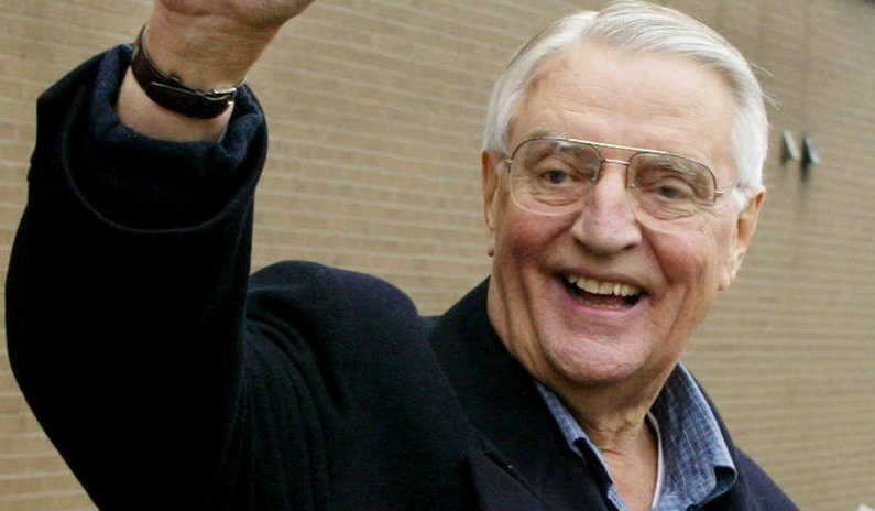 Walter Mondale posing for the camera: Former Vice President Walter Mondale waves to supporters in downtown St. Paul, Minn., in 2002.