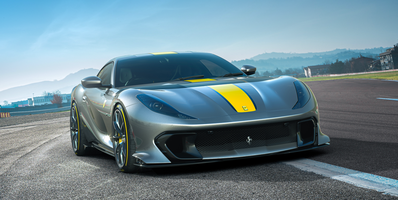 a car parked on the side of a road: With 819 hp, it's the most-powerful V12 Ferrari has done yet—and the highest-revving.