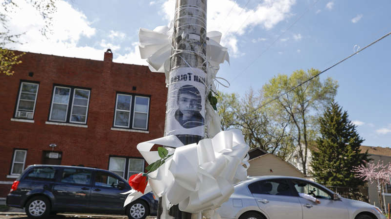 a car parked on the side of a building: A small memorial where 13-year-old Adam Toledo was shot and killed by a Chicago police officer in the Little Village neighborhood on April 15, 2021, in Chicago, Illinois.