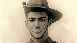 a man wearing a hat: Wilfred John Mann Hughes, 22, was killed while carrying a wounded captain in Belgium in 1918. (Supplied: Virtual War Memorial Australia)