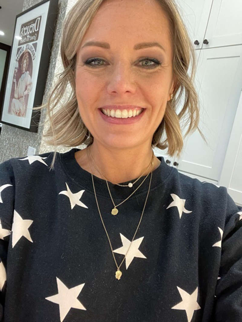 a person smiling for the camera: Dylan Dreyer wears a necklace with a breast milk pendant that resembles a dainty pearl. (Dylan Dreyer)