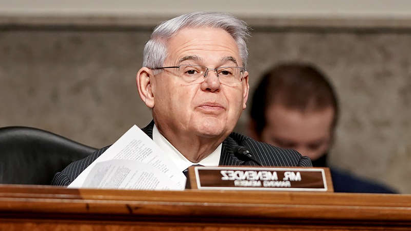 Bob Menendez sitting on a table: Lawmakers praise Biden for expected recognition of Armenian Genocide