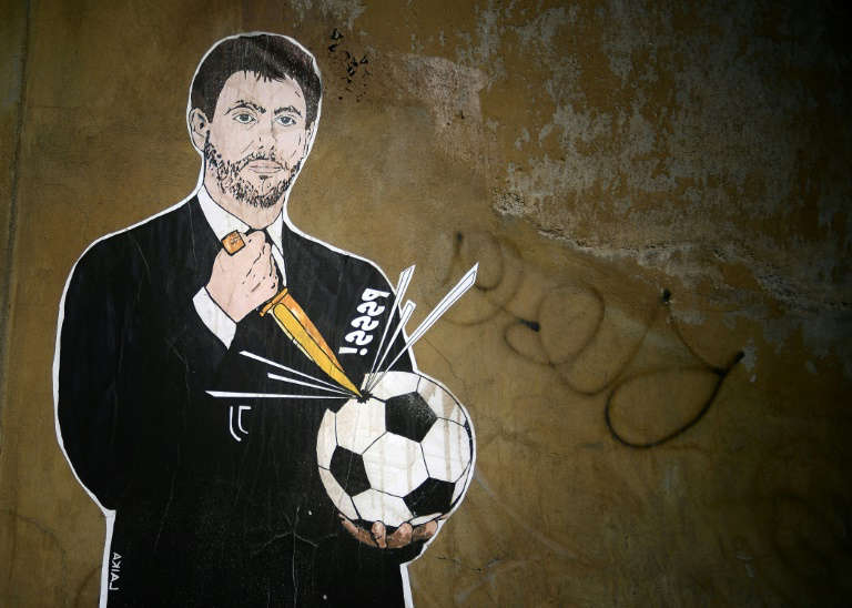 diagram: Juventus president Andrea Agnelli has been widely criticised for his role in the Super League proposal, not least in this mural by Italian artist Laika entitled 'The failed coup' near the headquarters of the Italian Football Federation in Rome