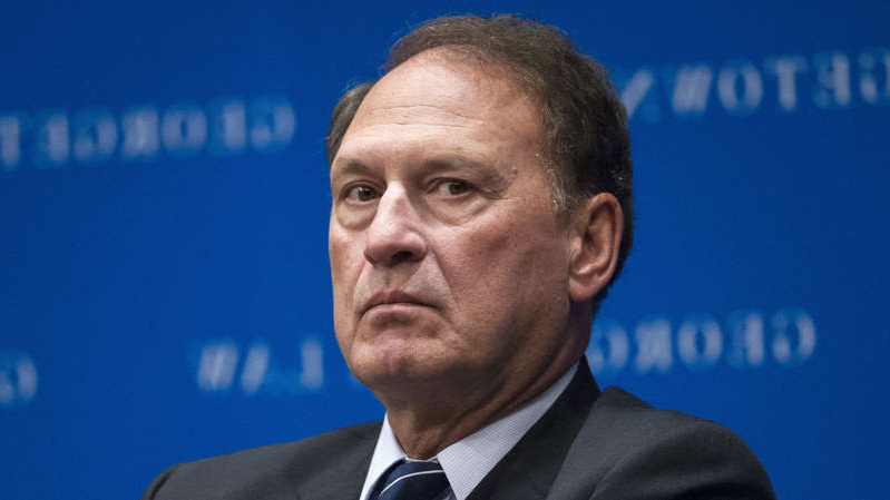 Samuel Alito wearing a suit and tie: Justice Samuel Alito participates in the opening panel of Georgetown Law Journal's annual symposium, in Washington, DC, on November 2, 2017.