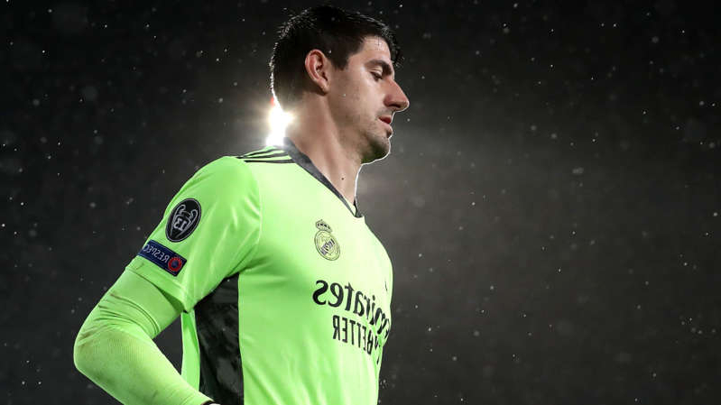 a man wearing a green shirt: Real Madrid goalkeeper Thibaut Courtois