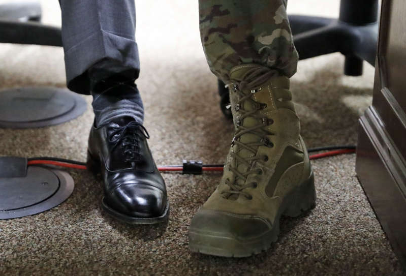 a pair of shoes: The boot of General John Nicholson (L) is seen next to the shoe of US Secretary of State Rex Tillerson at Bagram Air Field in Afghanistan on October 23, 2017. Tillerson paid a surprise visit to Afghanistan on October 23 to discuss Washington's new strategy with President Ashraf Ghani, the US embassy said. Tillerson reiterated the US commitment to working with the Kabul government and regional partners