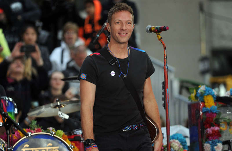 Chris Martin standing in front of a crowd: Coldplay