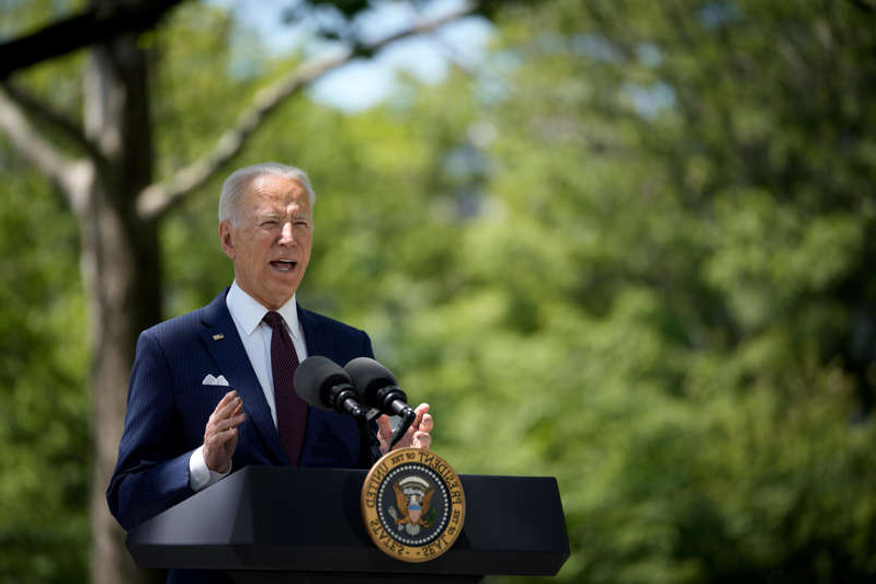 Joe Biden wearing a suit and tie: WASHINGTON, DC - APRIL 27: U.S. President Joe Biden speaks about updated CDC mask guidance on the North Lawn of the White House on April 27, 2021 in Washington, DC.