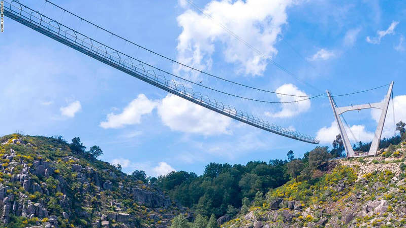 a bridge over a body of water: At 516 meters (1,692 feet), Portugal's Arouca 516 is the world's longest pedestrian suspension bridge.