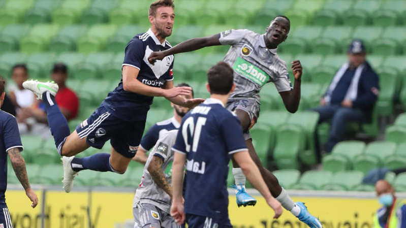 a group of men playing a game of football: Melbourne Victory and Central Coast have played out a 1- 1 draw in the A-League.
