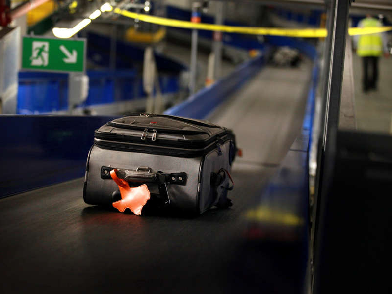 A 2010 photo shows a suitcase in the baggage organization system at Heathrow Airport in London (not the airport mentioned in the story). Peter Macdiarmid/Getty Images