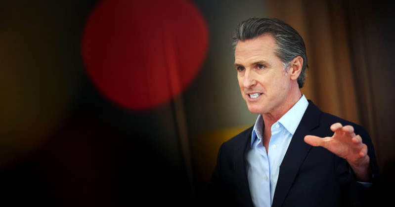 Gavin Newsom wearing a suit and tie: Is Newsom just the intended victim of partisan politics? Justin Sullivan/Getty Images