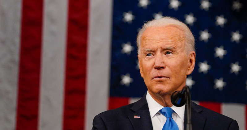 Joe Biden wearing a suit and tie: Biden needs to look to his left. Pool/Getty Images