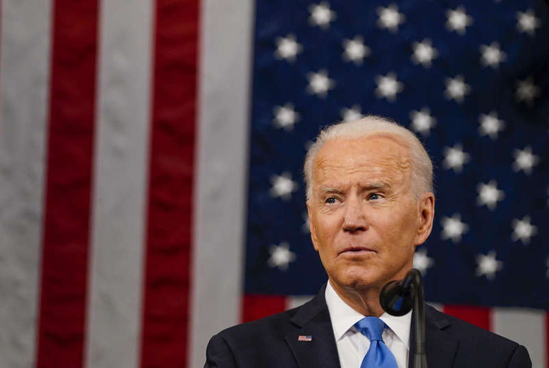 Joe Biden wearing a suit and tie: U.S. President Joe Biden addresses a joint session of Congress in the House chamber of the U.S. Capitol April 28, 2021 in Washington, DC. Biden issued 11 presidential proclamations on Friday.