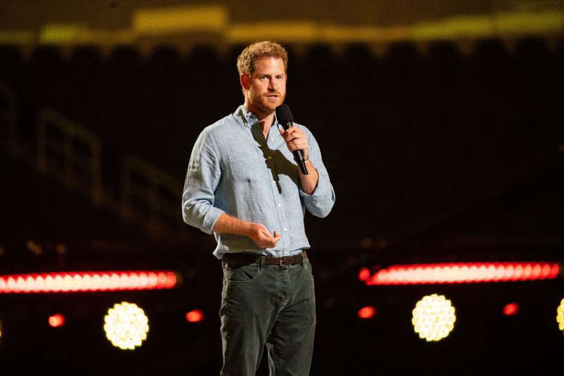 Prince Harry wearing a suit and tie: The Duke of Sussex returned to the spotlight on Sunday night
