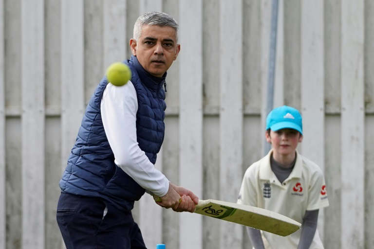 Sadiq Khan standing next to a fence: London Mayor Sadiq Khan, seen here on a campaign visit to Kingstonian Cricket Club last month, could win another term in office
