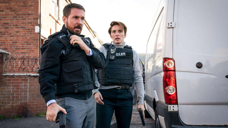 Vicky McClure, Martin Compston are posing for a picture: 'Should we go for upper arms or bums, gaffer?' Vicky McClure (DI Kate Fleming) and Martin Compston (DI Steve Arnott) are set to get permanent Line Of Duty tributes. All photos: BBC/World Productions/Steffan Hill