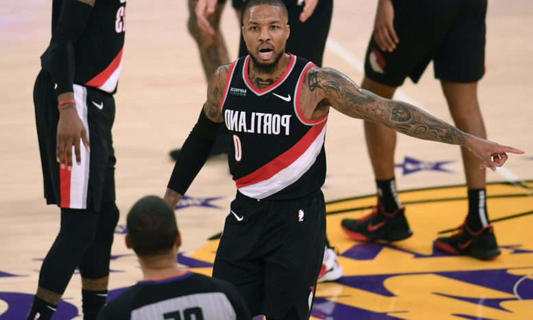 a group of basketball players: Damian Lillard on the court for the Trail Blazers.