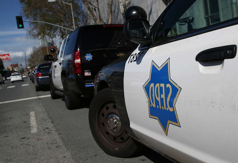 a police car parked on the side of a road: San Francisco Police Department